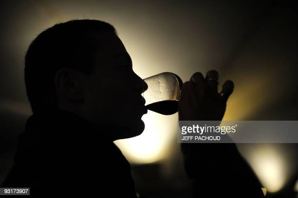 A man tests wine during the 149th edition of the Hospices de Beaune charity auction wine sale on November 15 2009 in Beaune central France The...