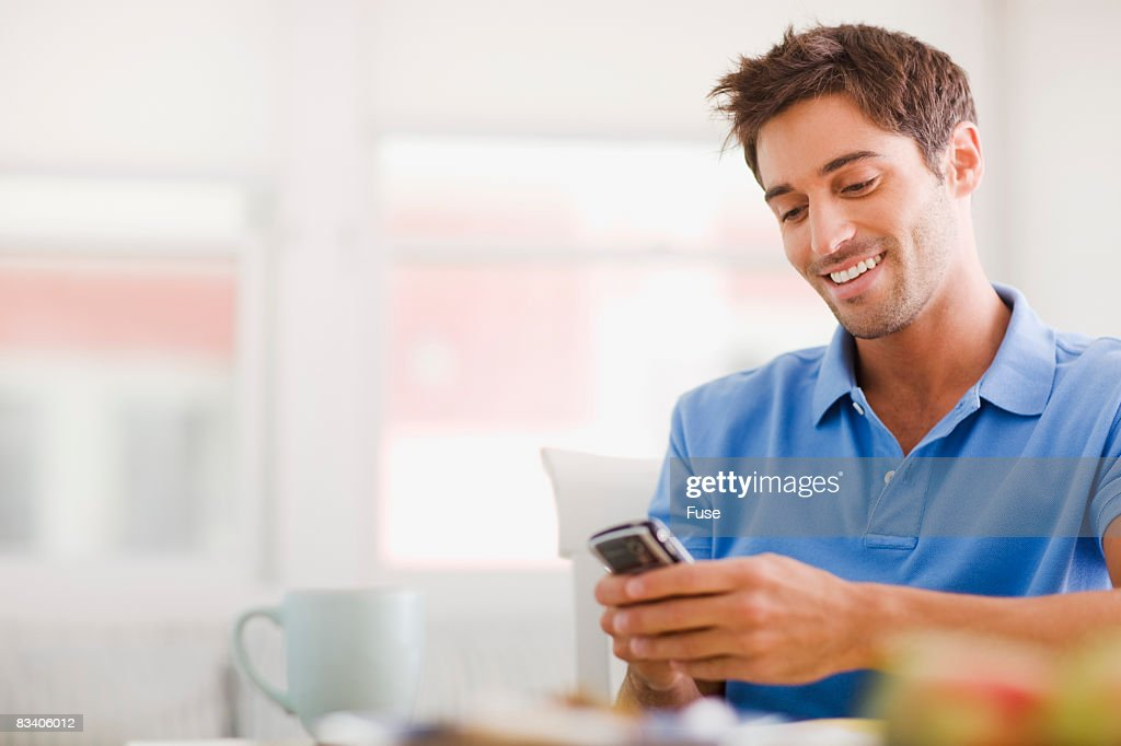 Man Text Messaging from Cell Phone