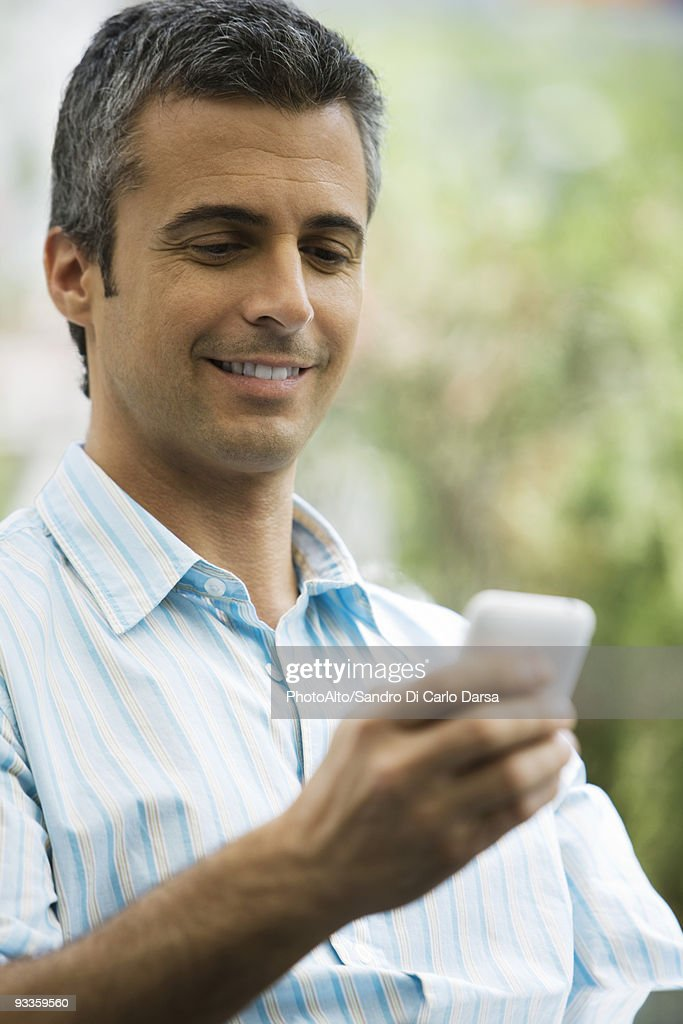 Man text messaging with cell phone