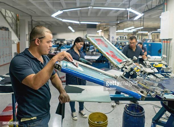 Man textile printing at a factory