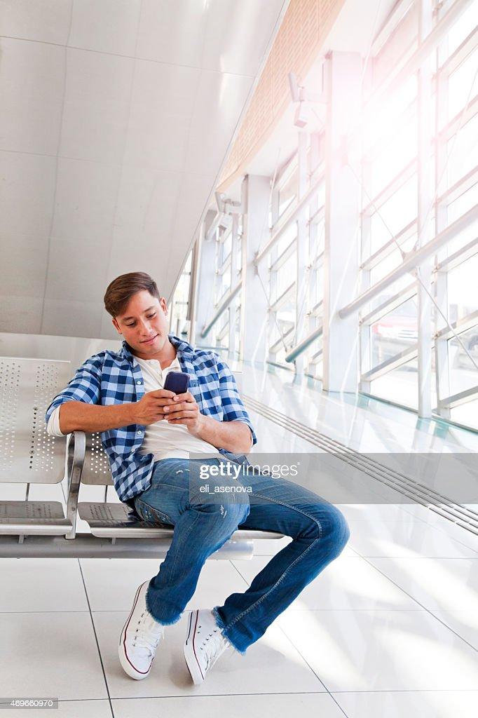 Man Texting in Dubai Metro.