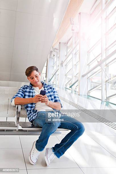 Man Texting in Dubai Metro.
