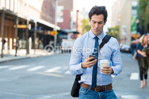 Man texting on phone : Stock Photo