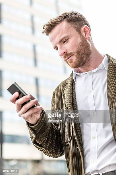 Man texting with smart phone