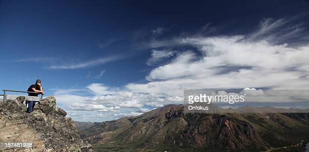 Man thinking with mountain landscape, Bariloche, Argentina