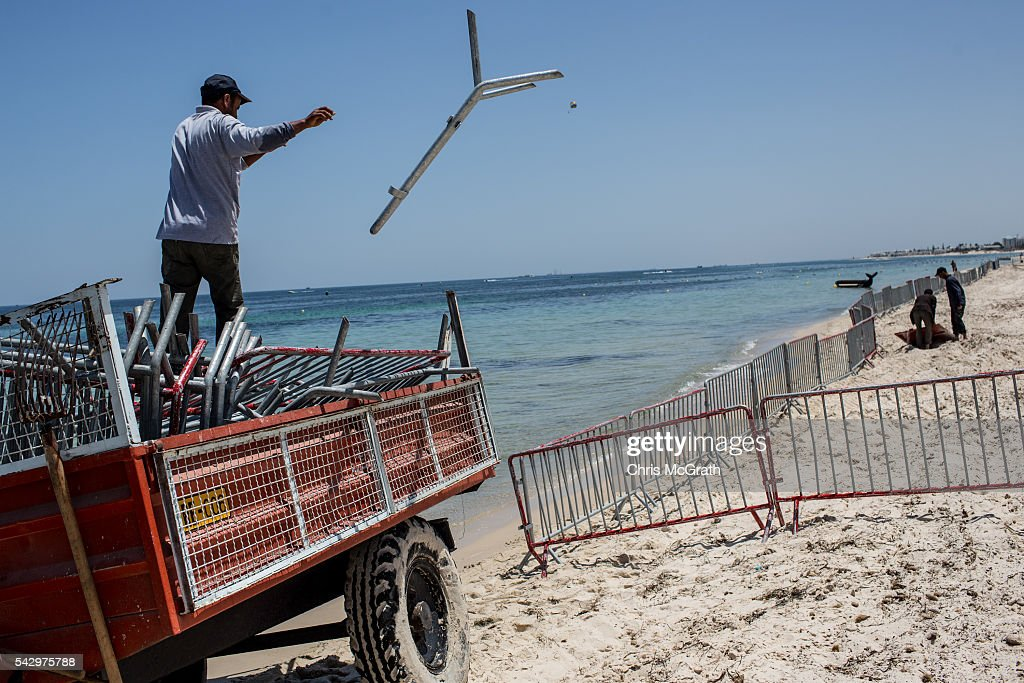 A man thows police barricades onto the beach in preparation for a memorial service for victims of the 2015 Sousse beach terrorist attack on June 25, 2016 in Sousse, Tunisia. Before the 2011 revolution, tourism in Tunisia accounted for approximately 7% of the countries GDP. The two 2015 terrorist attacks at the Bardo Museum and Sousse Beach saw tourism numbers plummet even further forcing hotels to close and many tourism and hospitality workers to lose their jobs. The 26th of June marks the first anniversary of the Sousse beach attacks.