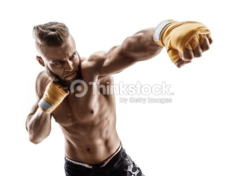 Man throwing a fierce and powerful punch. : Stock Photo