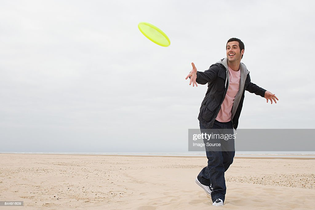 Man throwing a flying disc : Stock Photo