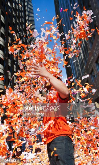 Man throwing confetti during a celebration