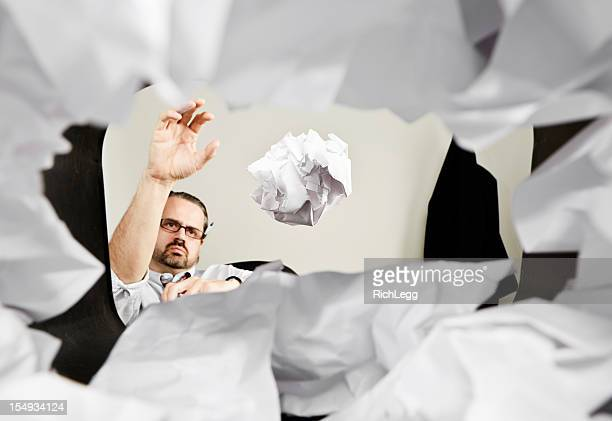Man Throwing Paper Into Wastepaper Basket