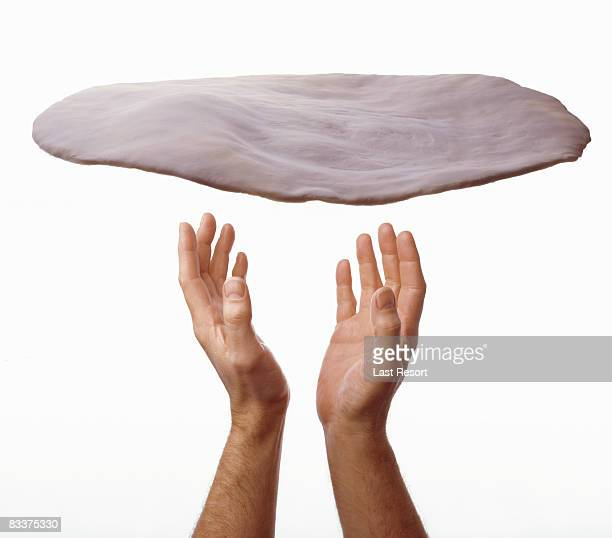 man throwing pizza dough