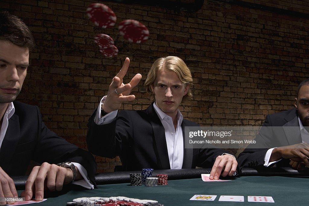 Man throwing poker chips in casino