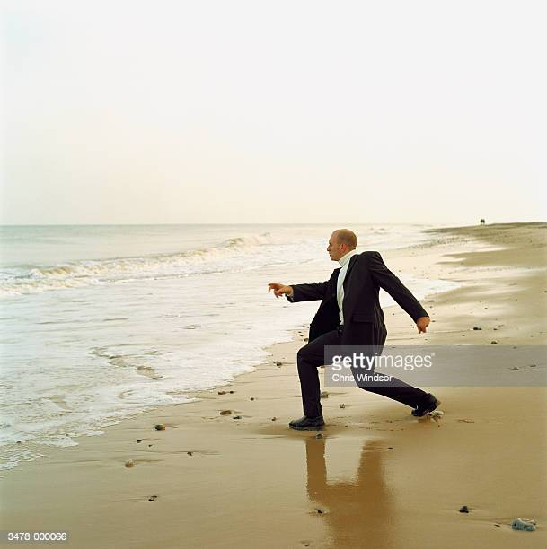 Man Throwing Stones into Sea