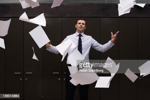 Man throws the papers into the air