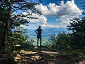 a man stands on an overlook near great smoky mountains national park along the appalachian trail.