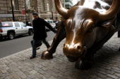 A man touches the bronze bull in the financial district January 22 2008 in New York City Following a sharp fall in international markets Monday the...