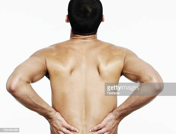 Man touching his back