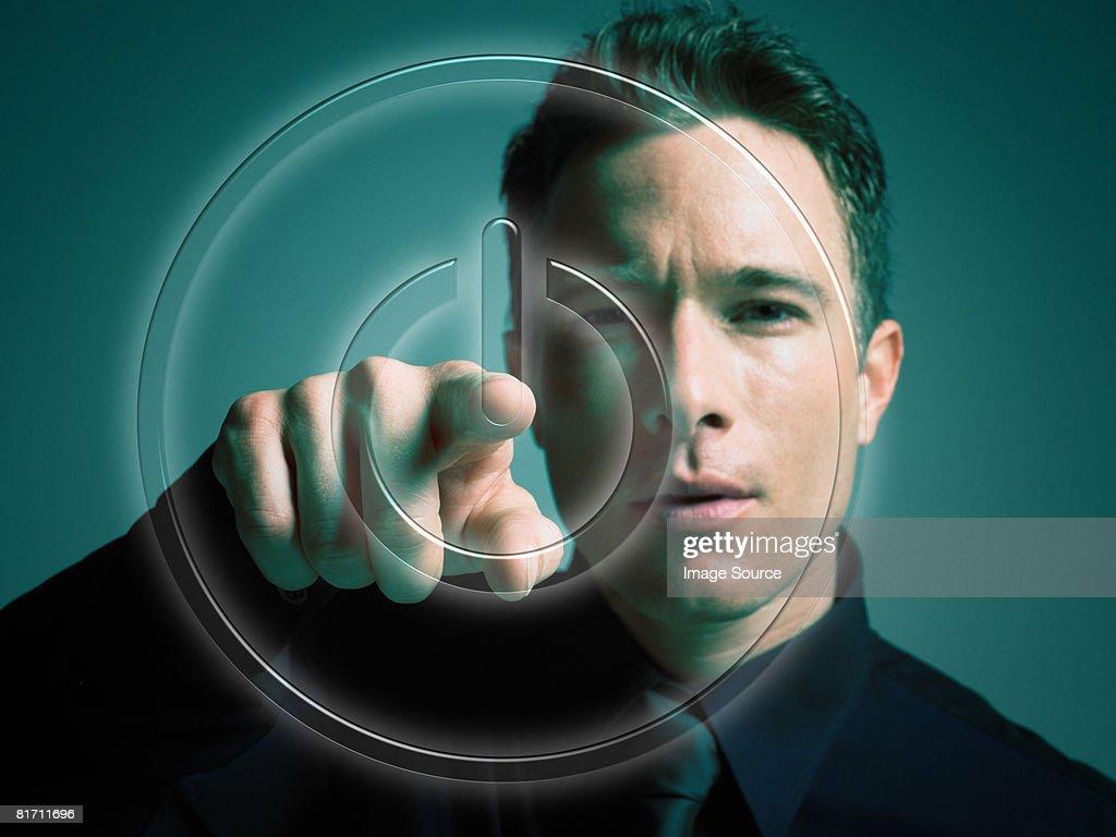 Man touching power button