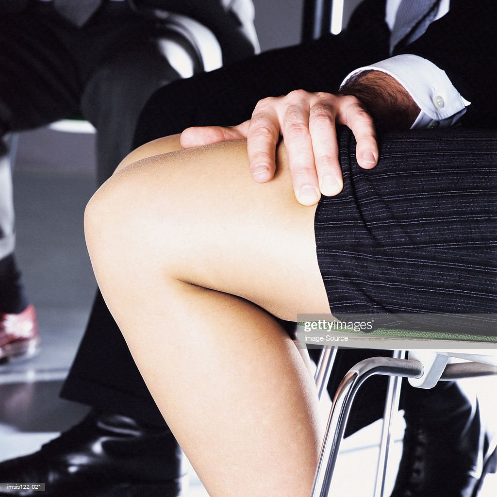 Man touching the legs of a woman : Stock Photo