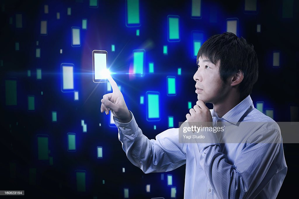 Man touching the smartphone : Stock Photo