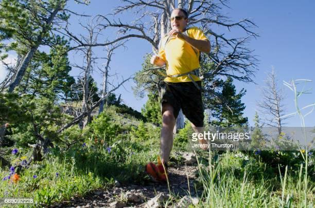 man trail running on beautiful summer day