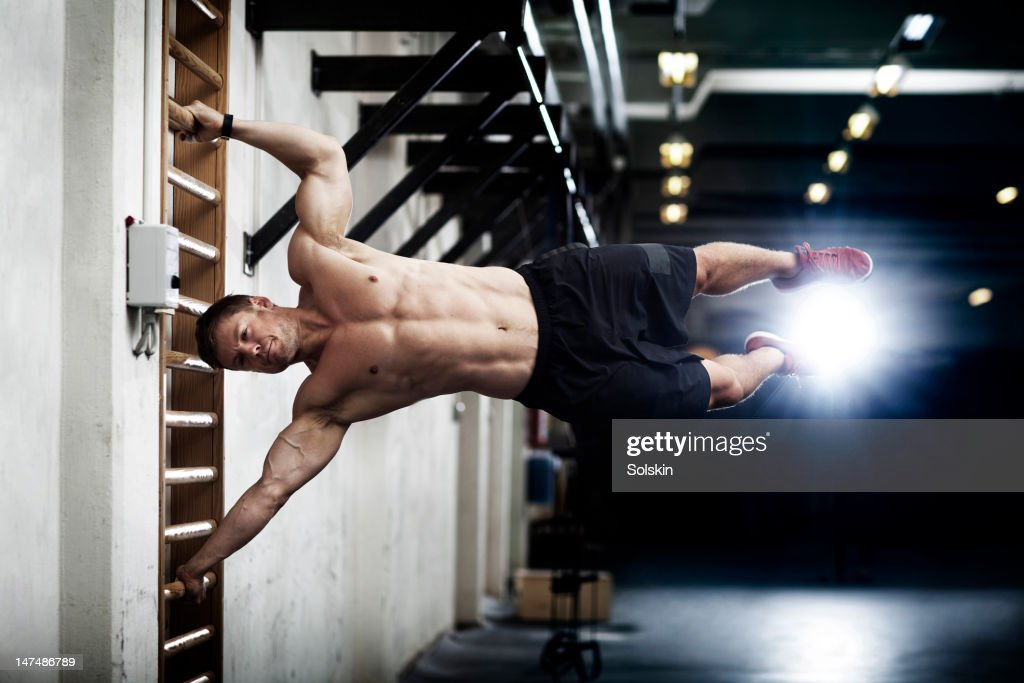 Man training in gym center : Stock Photo