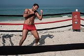 A man trains at a beach boxing ring at Pepe beach in Rio de Janeiro Brazil on July 26 2016 Since boxing trainer Moacyr Lima first installed a ring on...
