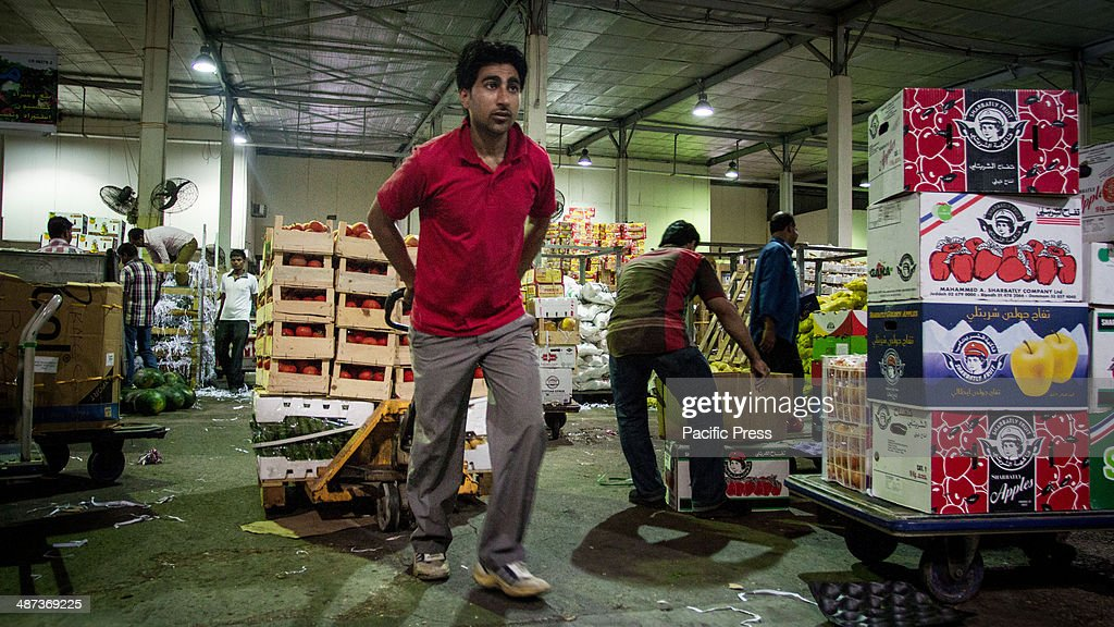A man transports vegetables in the Central Market.