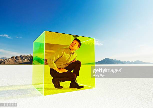 Man trapped in box on salt flats.