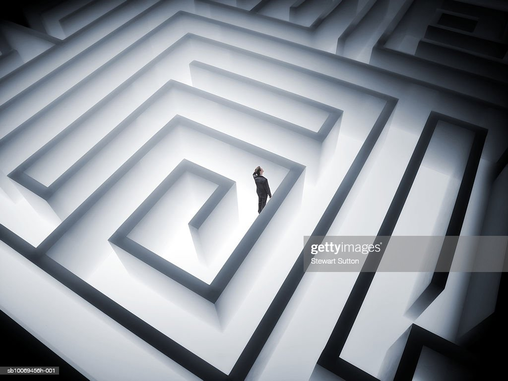 Man trapped in giant maze : Stock Photo