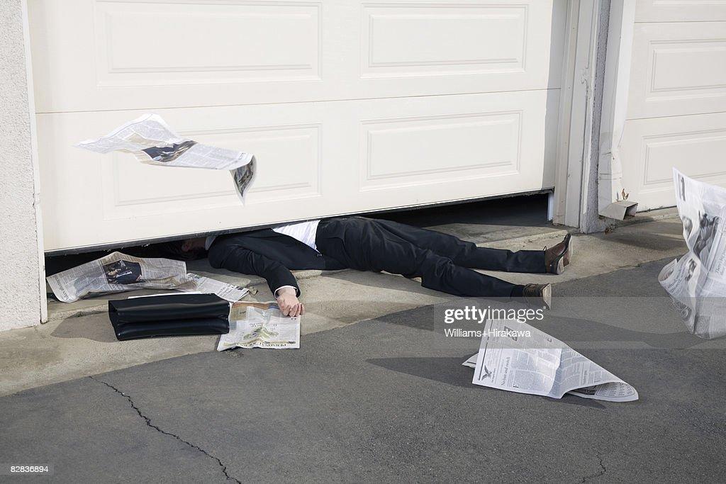 Man trapped under a garage door
