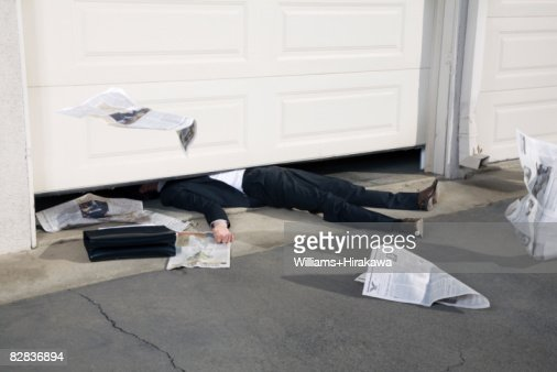 Man Trapped Under A Garage Door Stock Photo Getty Images
