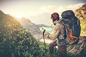 Man Traveler with big backpack mountaineering Travel Lifestyle concept lake and mountains on background Summer extreme vacations outdoor