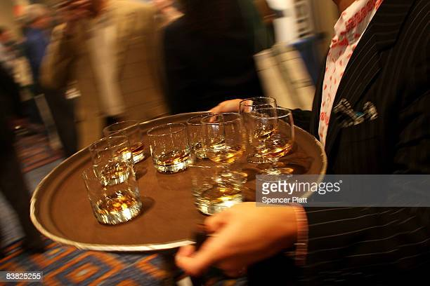 A man travels with a tray of scotch whiskey at the annual Big Smoke event on November 25 2008 in New York City Sponsored by the luxury magazine Cigar...