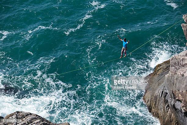 Man traverses highline above ocean swell