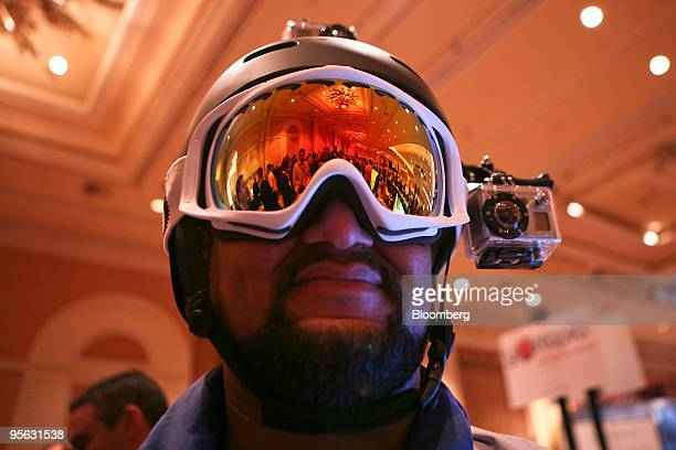 A man tries on a GoPro wearable digital camera rig during the Digital Experience event at the 2010 International Consumer Electronics Show in Las...