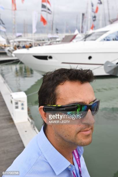 A man tries on a pair of connected glasses by the Garmin GPS manufacturer presented during the 44th Grand Pavois international inwater boat show on...