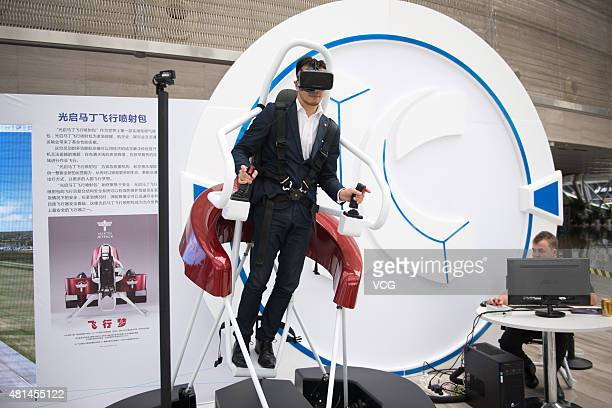 A man tries on Martin Jetpack simulator during an innovator conference organized by KuangChi Innovative Technology Ltd at Shenzhen Poly Theatre on...