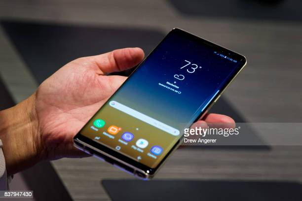A man tries the new Samsung Galaxy Note8 smartphone during a launch event August 23 2017 in New York City The Galaxy Note8 will be released in stores...