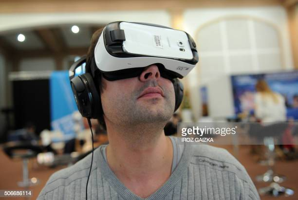 A man tries the virtual reality headset Gear VR for Galaxy by Oculus during the 29th edition of the Fipa on January 22 2016 in Biarritz southwestern...