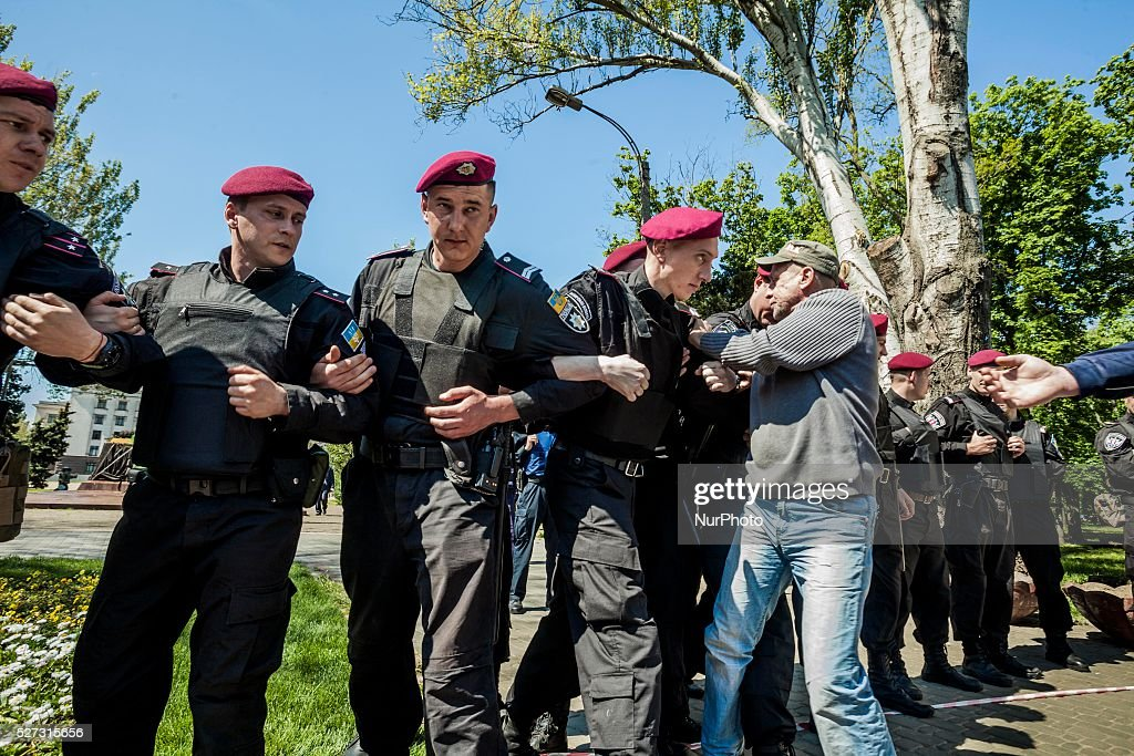 Man tries to break the police riot blockade in the entrance to Kulikovo Pole square in Odessa, southern Ukraine, on May 2, 2016, during the remembrance of the dead people in the Trade Unions House clashes on 2nd of May on 2014. The square was closed because a bomb threat.