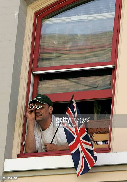 A man tries to get a better view from his window as Camilla Duchess of Cornwall arrives at the Empress Hotel Homeless Project on November 8 2005 in...