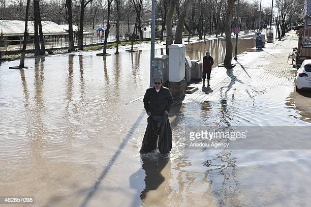 A man tries to pass across the water to reach a safe place as he stuck in the flood caused by the overflowed Tundzha and Maritsa rivers following...