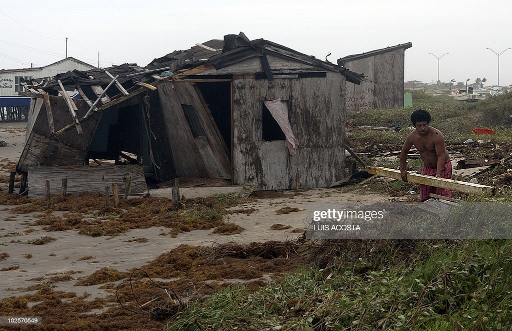A man tries to rebuild his damaged house after the passage of Hurricane Alex in Bagdad Beach, in Matamoros, Tamaulipas State, on July 1, 2010. Alex, the first hurricane of the Atlantic season, weakened across northeast Mexico as it neared high mountains on Thursday, after disrupting oil clean-up operations in the Gulf of Mexico. Alex was downgraded to a tropical storm after roaring ashore late Wednesday as a Category Two hurricane slightly south of the eastern US-Mexico border. AFP PHOTO/Luis Acosta