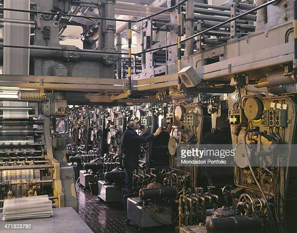 A man turning on a rotary press at the publishing house Arnoldo Mondadori Editore factory in Verona Verona 1964