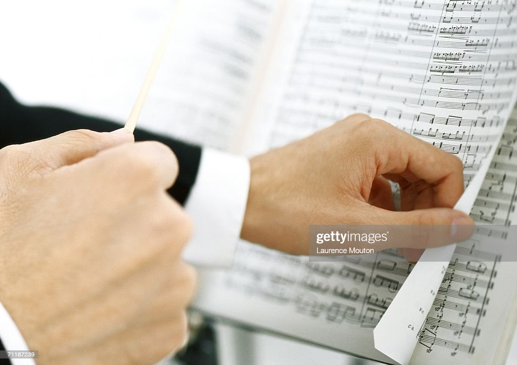 Man turning pages of sheet music : Stock Photo