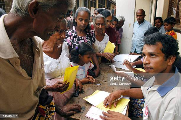 A man turns over his yellow slip given to him to record what relief he has all ready been provided with at a local school that has been turned into a...
