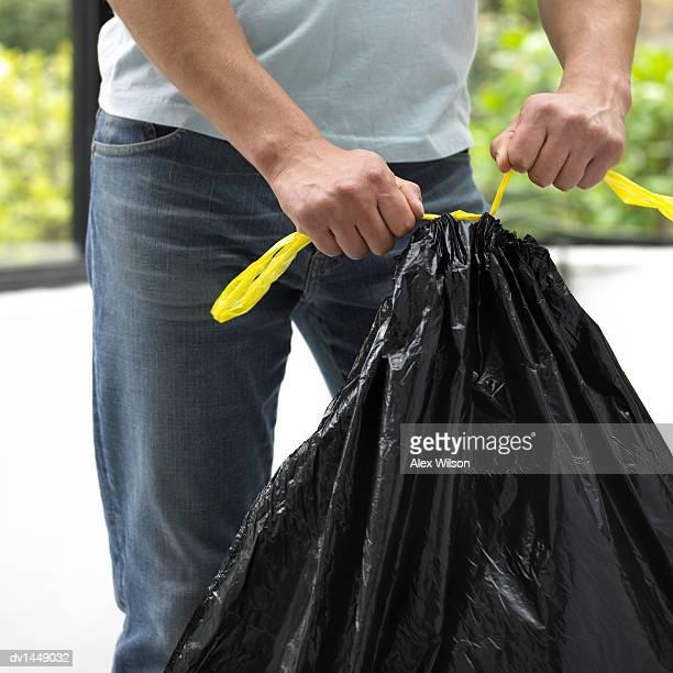 Man Tying a Bin Bag