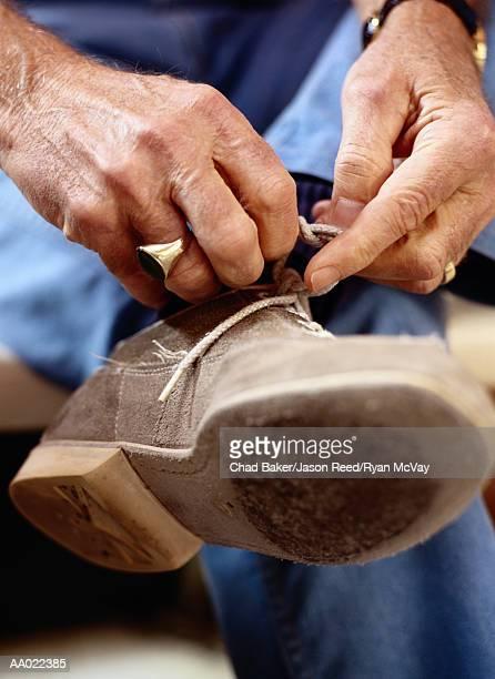Man Tying His Bowling Shoes