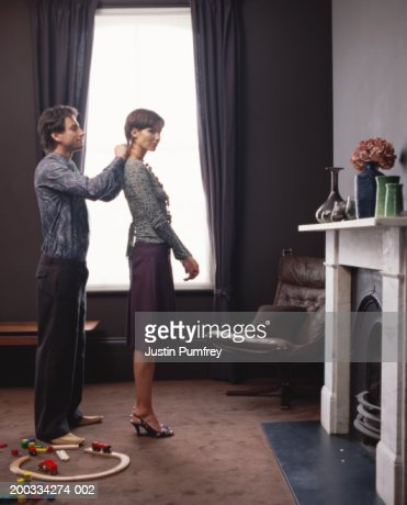 Couple Getting Dressed In Bedroom Toys On Floor Stock Photo ...